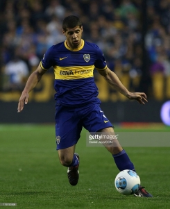 BUENOS AIRES, ARGENTINA - AUGUST 18: Emanuel Insua of Boca Juniors, drives the ball during a match between Boca Juniors and Atletico Rafaela as part of the Torneo Inicial 2013 at Alberto J. Armando Stadium on August 18, 2013 in Buenos Aires, Argentina. (Photo by Daniel Jayo/LatinContent/Getty Images)